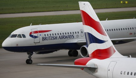 FILE PHOTO: British Airways planes are parked at Heathrow Terminal 5 in London