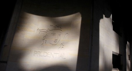 FILE PHOTO: Shadows are cast onto the logo of British life insurer Prudential on their building in London