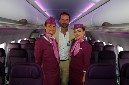 Skuli Mogensen, CEO of WOW air, poses with cabin crew members during a delivery ceremony of his first Airbus A321neo, during the 52nd Paris Air Show at Le Bourget Airport near Paris