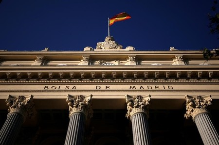 FILE PHOTO: A Spanish flag flutters above the Madrid Stock Exchange