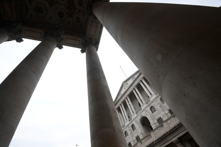The Bank of England is seen through the columns of the Royal Exchange in the City of London