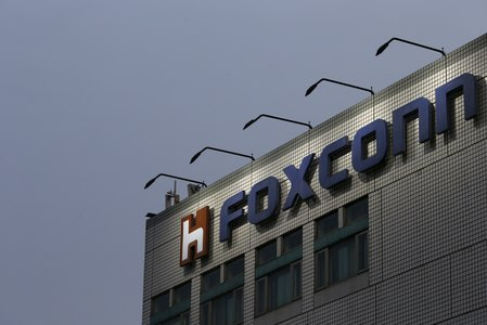 FILE PHOTO - The logo of Foxconn on top of the company's headquarters in New Taipei City Taiwan