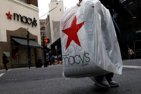 A customer exits after shopping at a Macy's store in the Brooklyn borough of New York