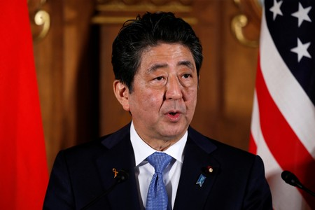 Japan's Prime Minister Shinzo Abe speaks during a news conference with U.S. President Donald Trump at Akasaka Palace in Tokyo