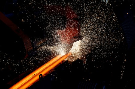 FILE PHOTO: A steel bar is cut at a Highveld Steel plant, which has a manufacturing agreement with ArcelorMittal steel company, in Middleburg