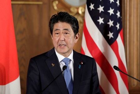 FILE PHOTO: Shinzo Abe, Japan's prime minister, speaks during a news conference with U.S. President Donald Trump, not pictured, at Akasaka Palace in Tokyo