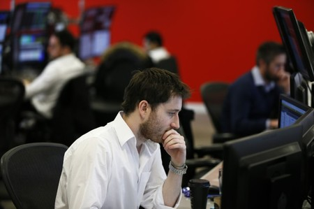 Market makers work on the trading floor at IG Index in London