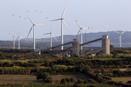Wind power turbines are seen behind the Carbosulcis establishment in Carbonia, west of Cagliari, during a protest 400 metres (1312 ft) underground by Sardinian miners as they block the entrance of the mine