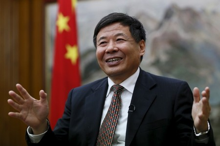 China's Vice Finance Minister Zhu Guangyao gestures during an interview with Reuters at the Chinese embassy in London
