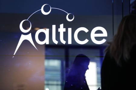 The logo of cable and mobile telecoms company Altice Group is seen during a news conference in Paris