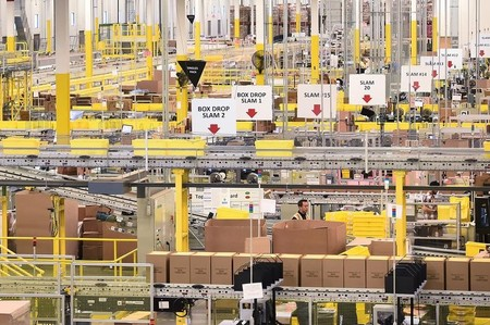 Workers process outgoing shipments at an Amazon Fulfillment Center on Cyber Monday in Tracy