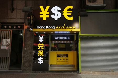 Monetary signs are seen at a currency exchange in Hong Kong