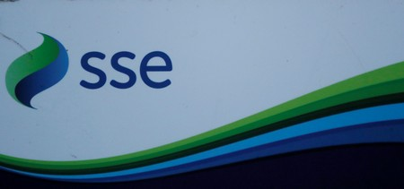 An SSE company logo is seen on signage outside the Pitlochry Dam hydro electric power station in Pitlochry
