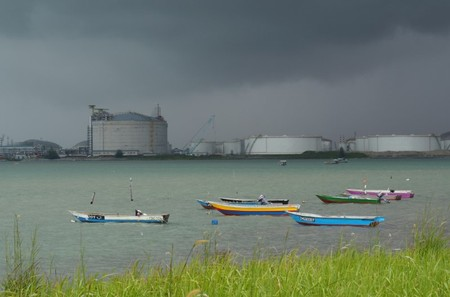 FILE PHOTO: Boats float in front of the VOPAK oil storage terminal in Johor