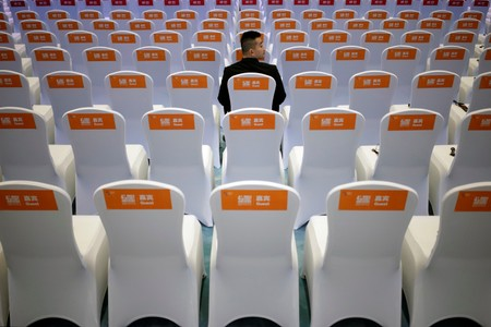 A security guard sits on a chair before the opening ceremony of the fourth World Internet Conference in Wuzhen
