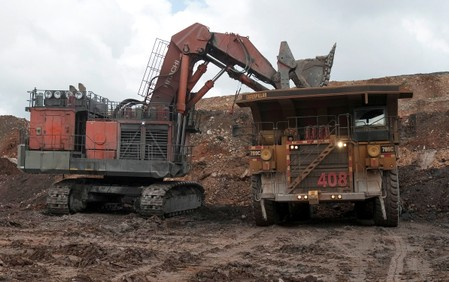 FILE PHOTO: A dump truck is loaded with gold ore at Barrick Gold Corporation's Pueblo Viejo gold mine in Cotui