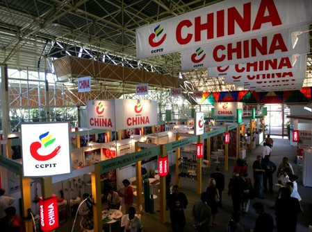 Visitors stroll through Chinas pavilion during Havana's International Trade Fair.