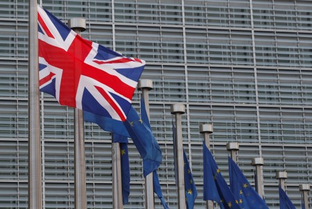 FILE PHOTO: Britain's and European Union flags are hung outside the EU Commission headquarters in Brussels