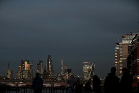 FILE PHOTO: The late winter light shines on the buildings in the City of London financial district of London