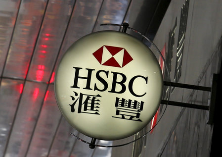FILE PHOTO: Logo of HSBC is displayed outside a branch at the financial Central district in Hong Kong