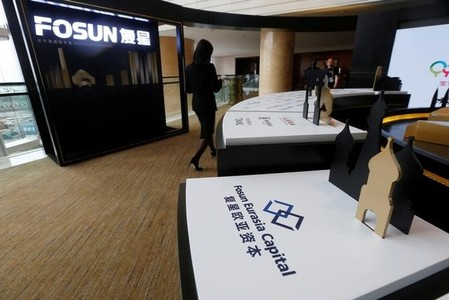 Fosun International Ltd services are displayed at a news conference in Hong Kong