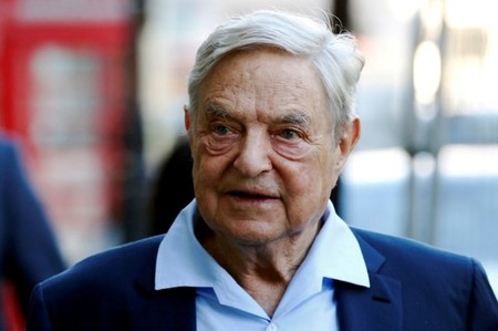 FILE PHOTO: Business magnate George Soros arrives to speak at the Open Russia Club in London