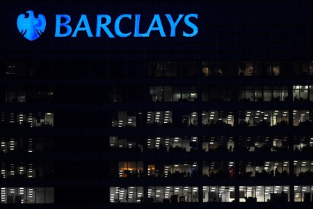 Workers are seen in at Barclays bank offices in the Canary Wharf financial district in London