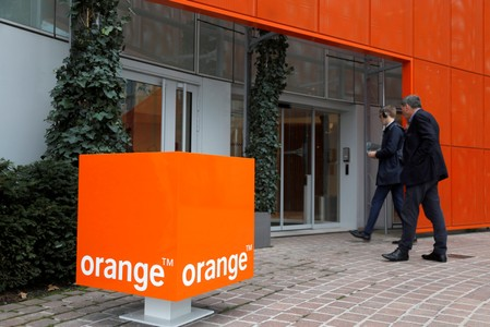 FILE PHOTO: The logo of French telecoms group Orange is seen at the entrance of the  Cyberdefense division headquarters at Nanterre