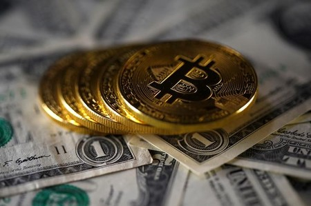 FILE PHOTO - Bitcoin (virtual currency) coins placed on Dollar banknotes are seen in this illustration picture