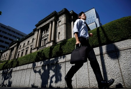 FILE PHOTO -  A man runs past the Bank of Japan (BOJ) building in Tokyo