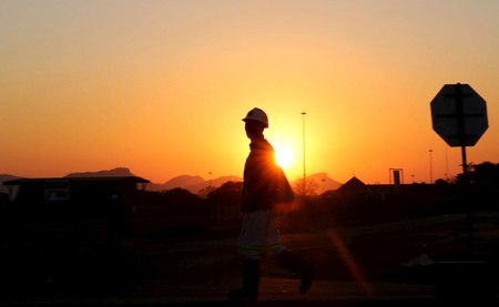 FILE PHOTO: A miner returns from his shift in Nkaneng township outside the Lonmin mine in Rustenburg