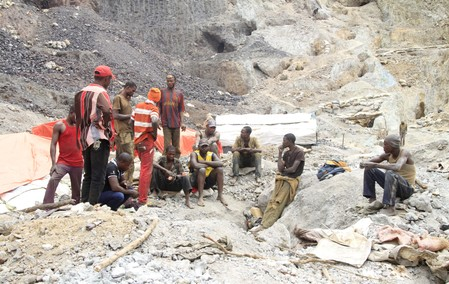 FILE PHOTO: Artisanal miners sit outside a cobalt mine-pit in Tulwizembe, Katanga province, Democratic Republic of Congo