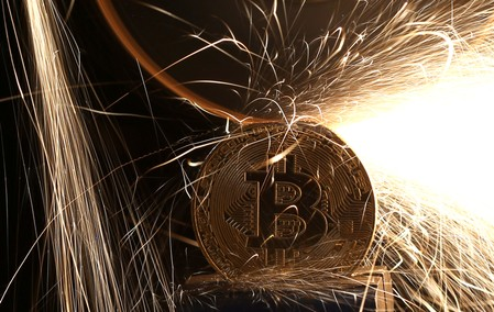 FILE PHOTO: Sparks glow from broken Bitcoin (virtual currency) coins in this illustration picture