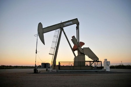 FILE PHOTO: A pump jack operates at a well site leased by Devon Energy Production Company near Guthrie,