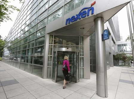 FILE PHOTO: A woman walks into the Nexen building in downtown Calgary