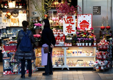 A clerk talks to a customer at a flower shop at a shopping mall in Tokyo