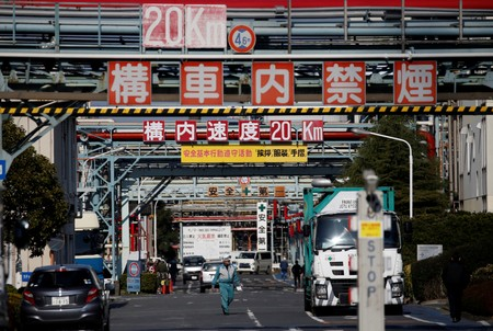 FILE PHOTO: Workers walk at a factory at the Keihin industrial zone in Kawasaki