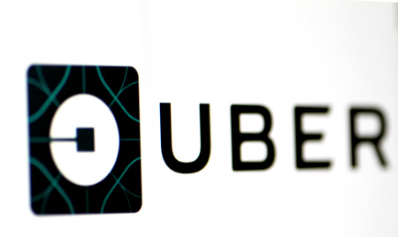 FILE PHOTO - The Uber logo is seen on a screen in Singapore