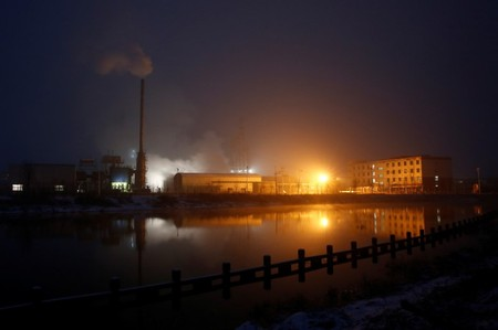Steam and smoke rise from a factory in the Guantao Chemical Industry Park in Handan