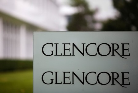 FILE PHOTO: The logo of Glencore is seen in front of the company's headquarters in Baar