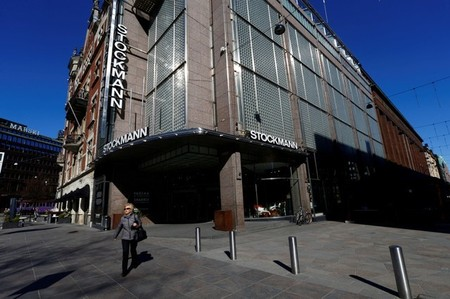 FILE PHOTO: A woman walks past Stockmann shopping center in Helsinki