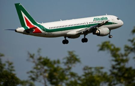An airplane of Alitalia approaches to land at Fiumicino international airport in Rome