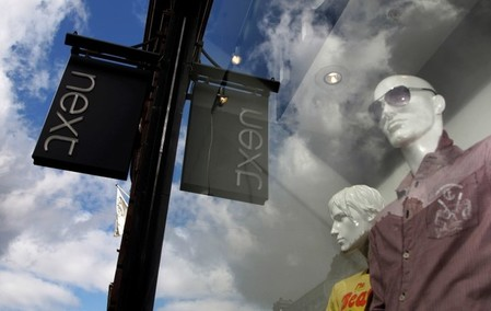 FILE PHOTO: Mannequins are pictured in the window of a Next clothing store in London