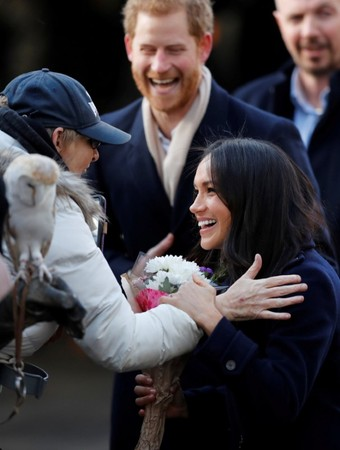 FILE PHOTO: Britain's Prince Harry and his fiancee Meghan Markle arrive at an event in Nottingham