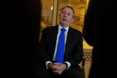 Britain's International Trade Secretary Liam Fox speaks during an interview at the residence of the British embassy in Beijing