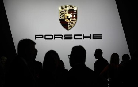 Members of the media and others gather for a news conference by Porsche at the Los Angeles Auto Show in Los Angeles