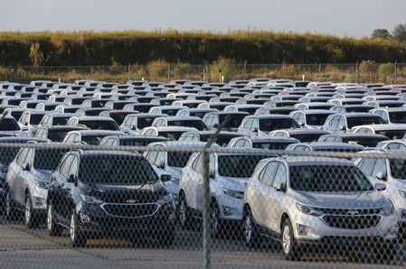 Chevrolet Equinox SUVs are parked awaiting shipment near the General Motors Co (GM) CAMI assembly plant in Ingersoll