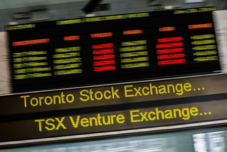 A sign board displaying Toronto Stock Exchange stock information is seen in Toronto