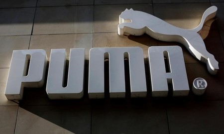 FILE PHOTO: The logo of German sports goods firm Puma is seen at the entrance of one of its stores in Vienna