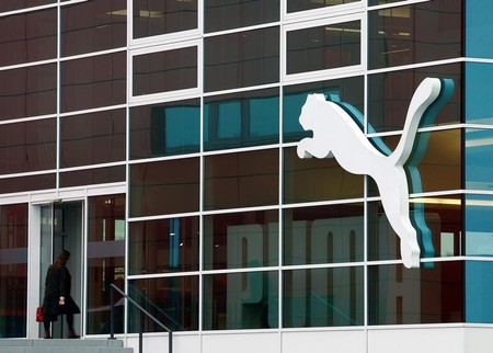 A woman enters the headquarters of German sports goods firm Puma in Herzogenaurach